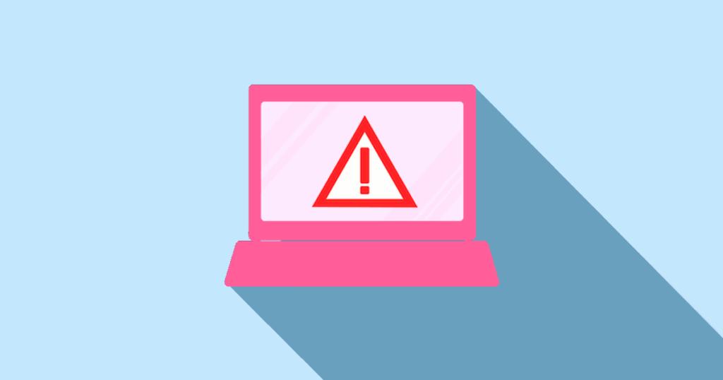 Actualizar WordPress en tu web: Motivos por los que debes hacerlo y riesgos por no hacerlo. Imagen decorativa, ordenador con un símbolo de advertencia.